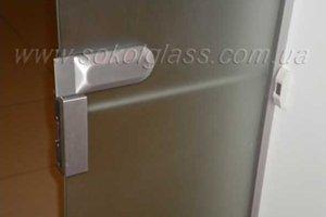 Электромеханическая защелка на маятниковые двери стеклянные